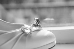 Weddings rings. Shoe with wedding rings in the sunshine Stock Photo