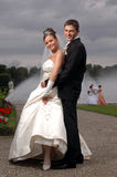 Weddings Two fanny outdoor. Wedding couple in the park with an other wedding at the background royalty free stock image