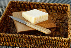 Wedge of Asiago Cheese in Basket with Knife Stock Images