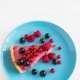 Currant tart blue plate. Wedge beautiful ripe currant tart top view blue plate square Stock Image