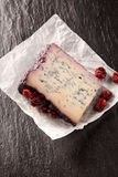 Wedge of Cheese Coated with Red Fruit Compote Royalty Free Stock Photo