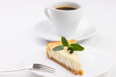 Wedge of cheesecake with leaves of mint Royalty Free Stock Photography