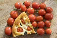 Wedge of flatbread at fresh tomatoes Royalty Free Stock Photos