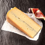 Wedge of Gourmet Cheese with Sliced Figs Stock Photography