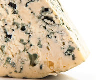 Wedge of gourmet cheese. On white background Royalty Free Stock Image