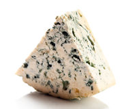 Wedge of gourmet cheese. On white background Stock Photo