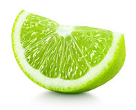 Wedge of green lime citrus fruit isolated on white Royalty Free Stock Photo
