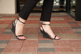 Wedge heels on paver block Royalty Free Stock Photography