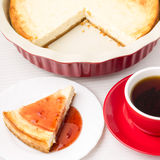 Wedge of homemade cheesecake with tea Royalty Free Stock Images