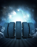 Wedge of new car wheels. Background is night sky Stock Images