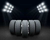 Wedge of new car wheels. Dark background with Stock Photography