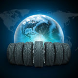 Wedge of new car wheels. Earth with light and. World map on dark blue background. Elements of this image furnished by NASA Royalty Free Stock Photo