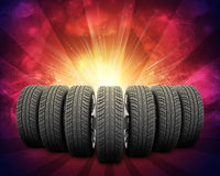 Wedge of new car wheels. Red background is galaxy Royalty Free Stock Photos
