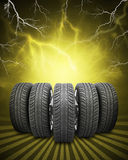 Wedge of new car wheels. Yellow background with Stock Photography