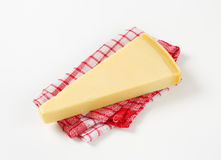 Wedge of Parmesan cheese Stock Photo