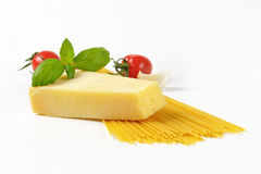 Wedge of parmesan cheese and spaghetti Royalty Free Stock Image