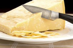 A Wedge of Parmigiano-Reggiano on Plate Stock Photography
