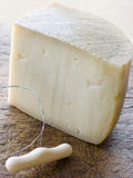 Wedge of Pecorino Cheese. With cheese slice Royalty Free Stock Image