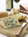 Wedge of Roquefort Cheese with Rustic Baguette Stock Images