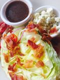 Wedge Salad. Bacon Blue Cheese vegetables plated Royalty Free Stock Images