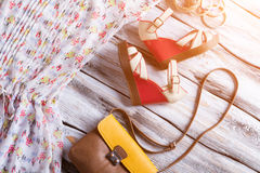 Wedge sandals and bicolor purse. Royalty Free Stock Photo
