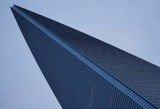 Wedge-shaped skyscraper points to the heavens Stock Photo