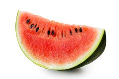 Wedge of watermelon with seeds isolated on white. With rind royalty free stock image