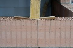 Wedged. Securing a square timber, on a construction site Stock Photography