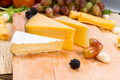 Wedges of assorted cheeses on a board Royalty Free Stock Photo