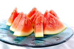 Wedges of watermelon. Watermelon wedges arranged on blue glass plate Stock Photography