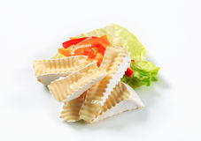 Wedges of white rind cheese. And vegetable garnish royalty free stock image