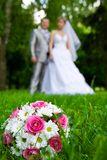 Wedding bouquet on a grass Royalty Free Stock Image