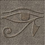 Eye of Horus chiseled in granite. The Wedjat or eye of Horus, an egyptian symbol chiseled as a relief in granite royalty free stock image