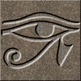 Eye of Horus chiseled in granite. The Wedjat or eye of Horus, an egyptian symbol chiseled as a relief in granite royalty free stock photography