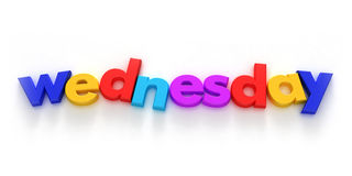 Wednesday. Word formed with colourful letter magnets on neutral background Royalty Free Stock Photo