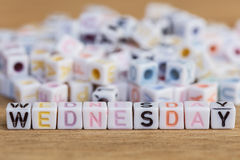 Wednesday written in letter beads on wood background Stock Photography