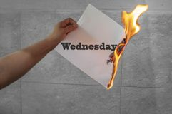 Wednsday word text on fire with burning paper. In hand stock image