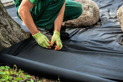Weed barrier sheet installation Royalty Free Stock Photos
