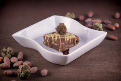 Weed brownie plate with cacao beans Royalty Free Stock Photos