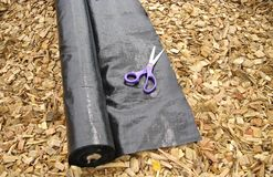 Weed matting mulch and scissors Stock Photography