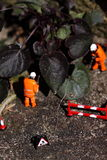 Weed miniature model workers B Stock Photo