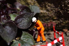 Weed miniature model workers C Royalty Free Stock Images