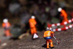 Weed miniature model workers D Royalty Free Stock Photo