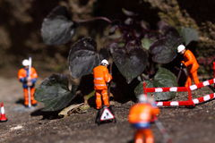Weed miniature model workers E Stock Image