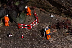 Weed miniature model workers J Stock Image