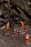 Weed miniature model workers L Royalty Free Stock Images