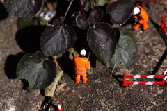 Weed miniature model workers A Stock Photo