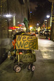 Weed is a necessary life function. Homeless sign with need weed message royalty free stock photography
