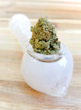 Weed pipe with bud. Marijuana pipe filled with weed royalty free stock image