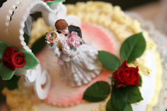 Weeding cake. With girl and boy figurines Stock Photography